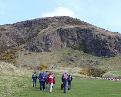 Deep Time Walk group in front of Arthur's Seat